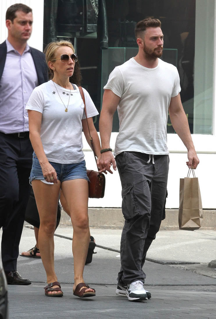 Sam and Aaron Taylor-Johnson hold hands while out for a ...