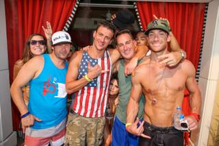 Ryan Lochte, center, and friends at Encore Beach Club on Sunday, Aug. 31, 2014, in Las Vegas.