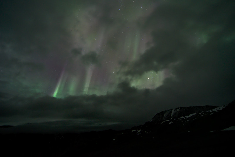 It was cloudy almost all night. Then, at 3am there was a small break, and then the aurora exploded through it. This lasted for about two or three minutes before the aurora moved off to the south and out of my little window. Then the window closed, then it snowed.