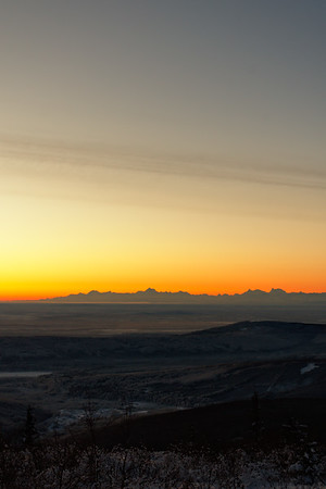 Watching the sunrise from Ester Dome outside of Fairbanks, Alaska. Warm tones take over the Alaska Range as the sun nears the horizon.