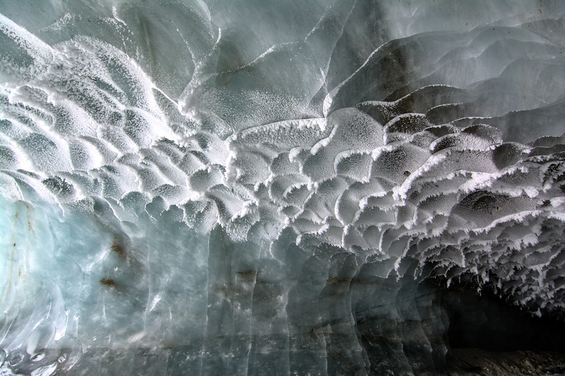 Frost on the ceiling of a blue glacier cave