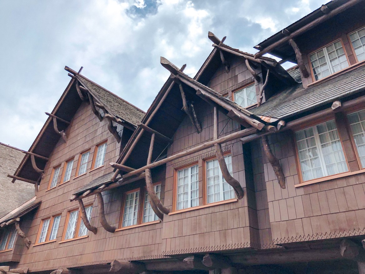 Yellowstone Vacation: A front exterior view of the Old Faithful Inn in Yellowstone National Park, Wyoming.  The iconic Lodgepole Pine lodge sits near Old Faithful and the Upper Geyser Basin near the Firehole River.