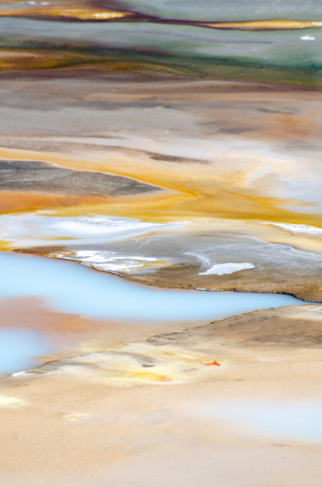 Yellowstone Hot Springs: Multi-colored pools in Yellowstone's Norris Geyser Basin.
