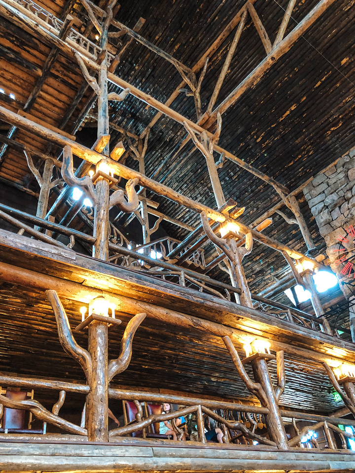 Yellowstone's Old Faithful Inn. An interior view of Yellowstone National Park's Old Faithful Inn. Lodgepole Pine beams support the high roof structure inside the iconic Lodge near the Old Faithful Geyser.