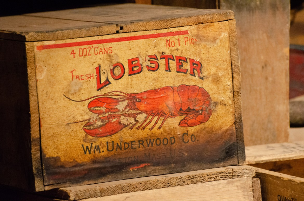A box of canned lobster for sale inside John Day, Oregon's Kam Wah Chung & Company, the most significant collection of 19th and 20th Century artifacts documenting Chinese immigrants in the American West.  Other packages and items for sale sit nearby in the Company's store.
