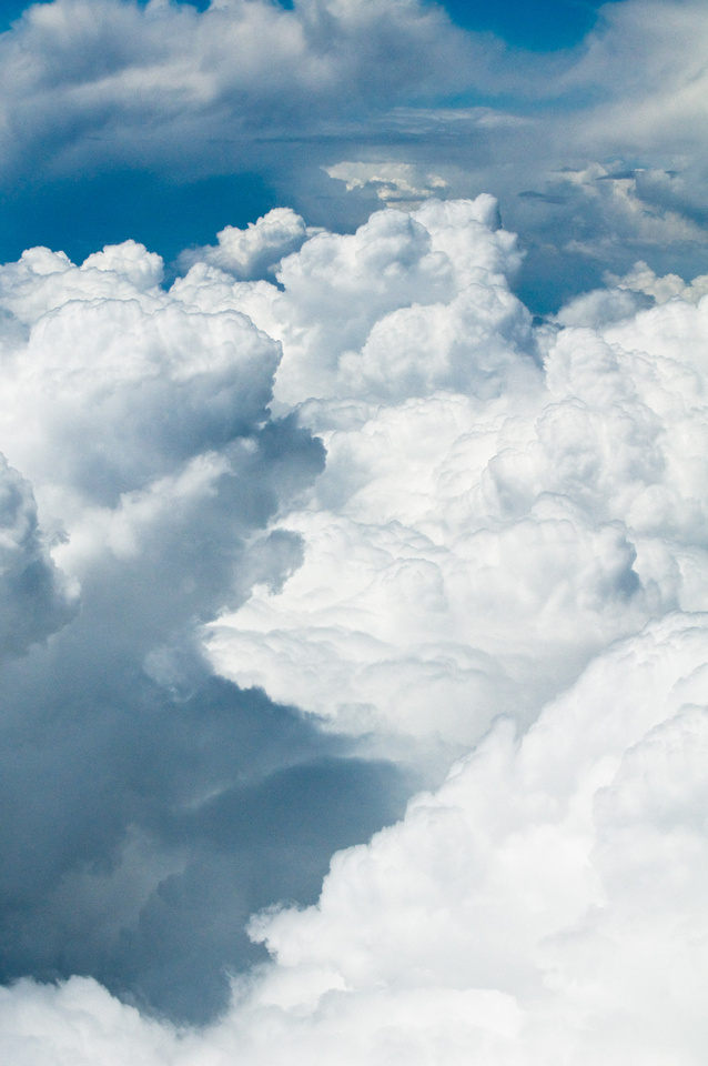 Creative Photography - Free Cloud Background Images. Puffy white clouds billow and float above Central Mexico near Mexico City.
