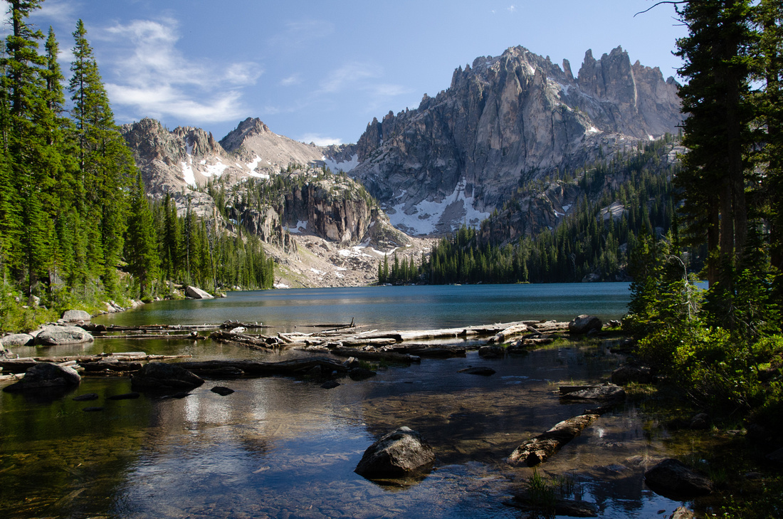 Best Baron Lakes Idaho Hikes - Grandjean Campground and Trailhead to Redfish Lake.  The Baron Creek Trail leads hikers along the outlet stream to the lake, surrounded by towering, jagged Sawtooth peaks.