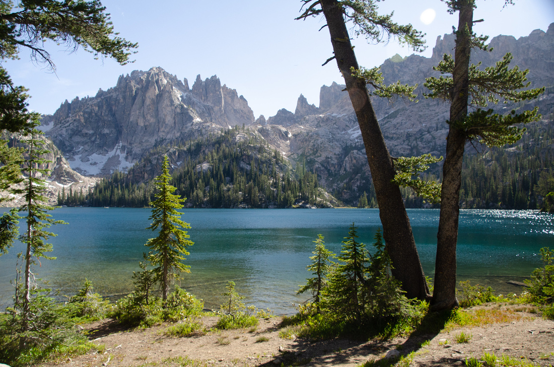 Best Baron Lakes Idaho Hikes - Grandjean Campground and Trailhead to Redfish Lake.  A view of the middle Baron Lake and surrounding peaks from the main camping area on the North Shore.