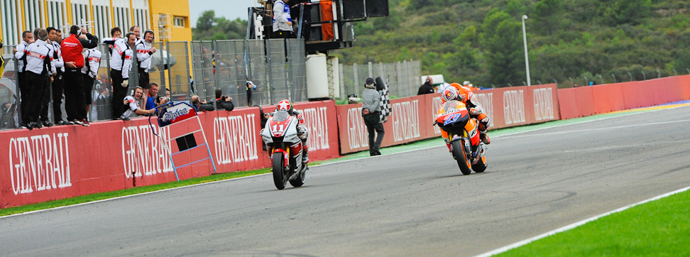 Stoner powers to Valencia victory