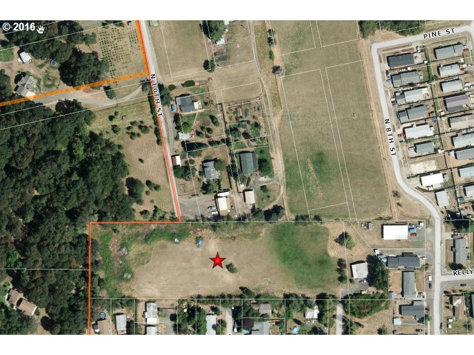 3.62 Acres in town in Residential neighborhood. The city said last year that is possible to build 10 to 11 lots, seller started preliminary drawings but the plans must be submitted to the city planner for approval before building. Buyer must due own due diligence and buyer must submit to City  to get City Approval. Water & Sewer available at street