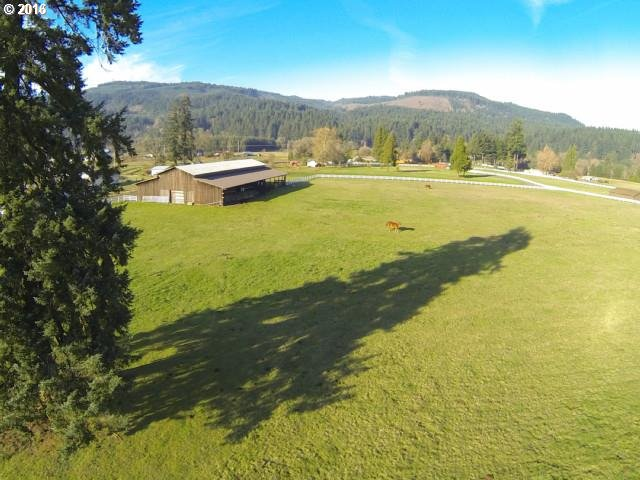 360-degree view of heavenly McKenzie Valley.  Ready for your dream home - or two!  Two separate lots sold together for total of 17.25 acres.  Gated, fenced, well and power in place.  Large barn suitable for any need.  Seller financing may be available with suitable down payment.  Address is 41400 McKenzie Hwy