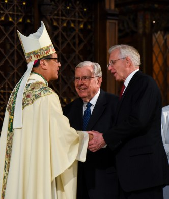 Francisco Kjolseth | The Salt Lake Tribune Bishop Oscar A. Solis greets M. Russell Ballard, center, and D. Todd Christofferson of the Quorum of the Twelve Apostles of the LDS Church during installation ceremonies at the Cathedral of the Madeleine.