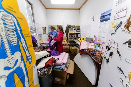 Carol and Netty, FLDS members, pack donations into relief kits that will be given to children evicted from UEP Trust homes, in Colorado City, Ariz.