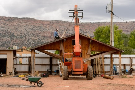 An FLDS man struggles to remove a shed from a Colorado City, Ariz., property as the UEP Trust evicts him, Tuesday May 9, 2017.