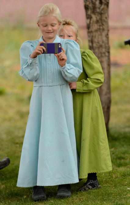 An FLDS girl takes video as her family is evicted from a Colorado City, Ariz., home, Tuesday May 9, 2017.