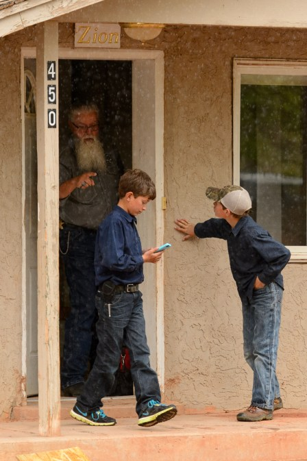 Mohave County Constable Mike Hoggard orders FLDS boys away from a Colorado City, Ariz., home where the locks are being changed, Tuesday May 9, 2017. One of the boys had been taking videos of the eviction process, crossing the property line after it had been cleared.