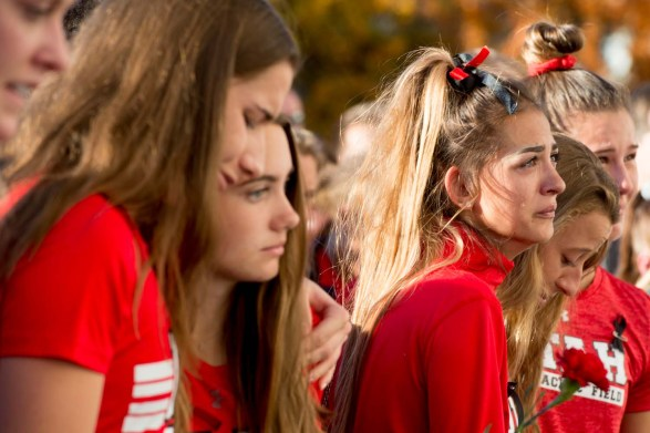 (Jeremy Harmon | The Salt Lake Tribune) Members of the University of Utah track team hold each other during a vigil for teammate Lauren McCluskey on Oct 24. McCluskey was killed on campus earlier that week.