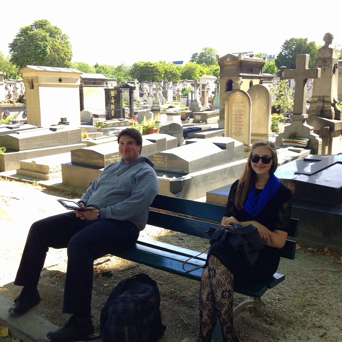 Eric and Michelle Relaxing on a Park Bench in the Montparnasse Cemetery of Paris, France
