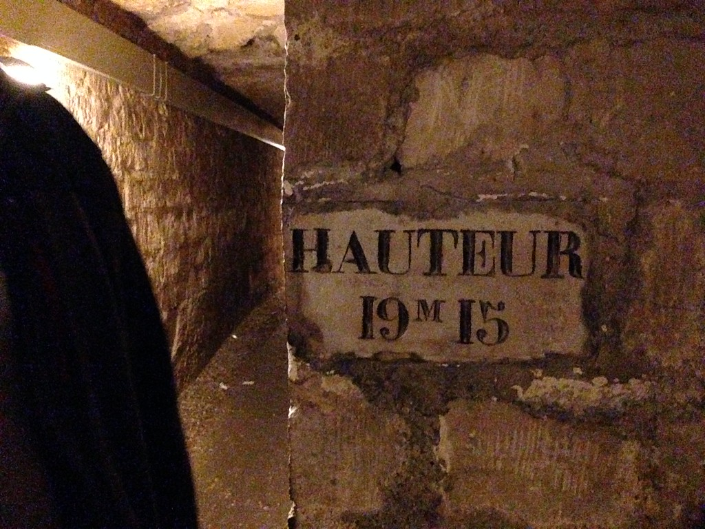 An Old Street Coordinate Marking in the Catacombs of Paris, France