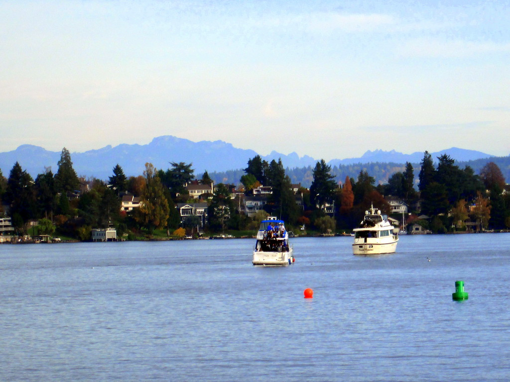 Two Tailgating Boats Drift Toward the University of Washington on our Argosy Lakes Cruise