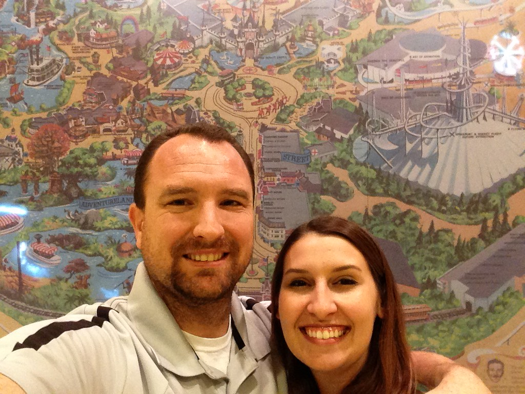 Dan and I With a Wall-Sized Park Map Print in the Lobby of the Disneyland Hotel
