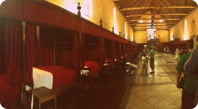 The Great Hall of the Poor at the Hospices de Beaune is Filled With Hospital Beds
