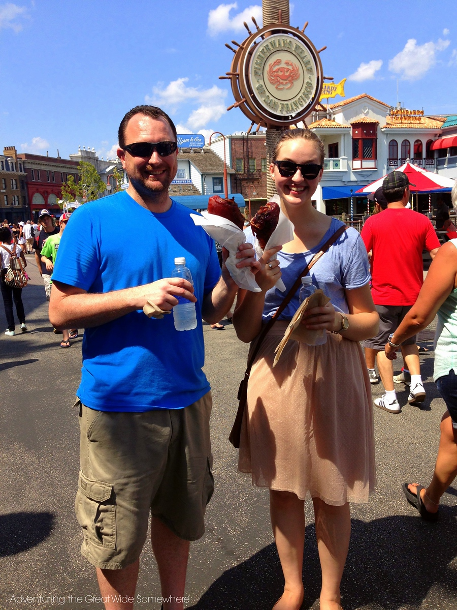 Michelle and Dan eating turkey legs in the Fisherman's Wharf area of Universal Studios Florida