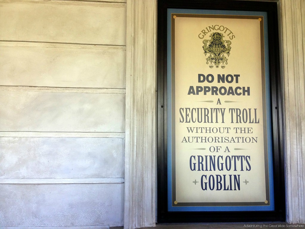 A sign at Gringotts Bank reads, do not approach a security troll without the authorisation of a Gringotts goblin