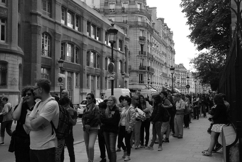 Black and White Photo of Tourists Waiting to Enter the Towers of Notre Dame Cathedral in Paris