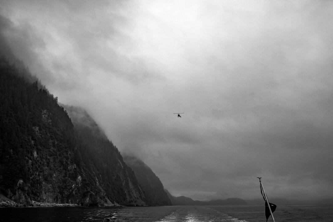 A helicopter in Resurrection bay during  a major marine tour of Kenai Fjords National Park out of seward, Alaska. Taken by Kimberly Kendall of Clicking with Kim