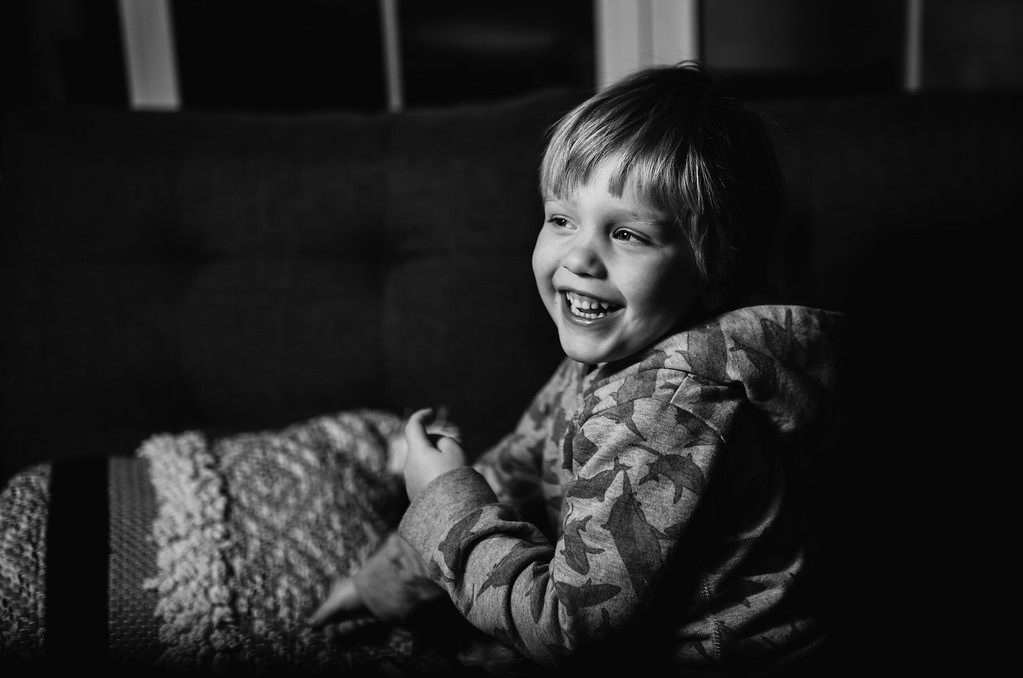 small boy laughing