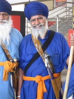 A Sikh man with sword in traditional clothing