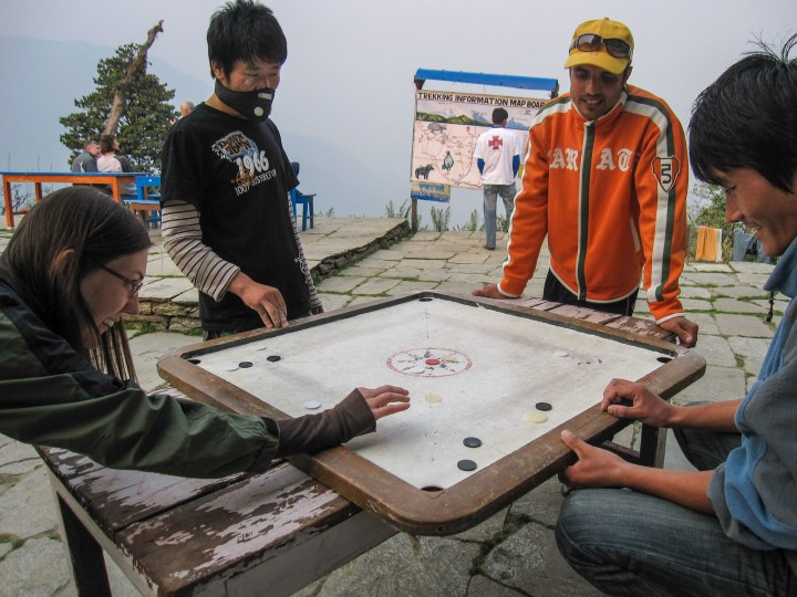 leanring how to play carrom nepal