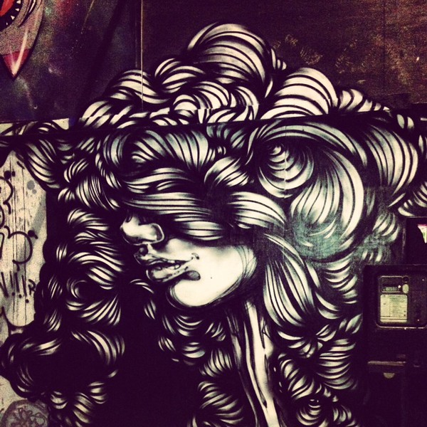 woman street art in East London