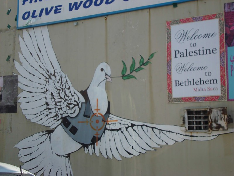 Dove street art mural in Palestine