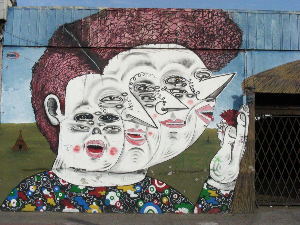 street art piece depicting a four-headed woman