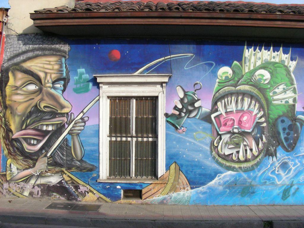maritime-inspired street art on a hostel wall in Barrio Brasil
