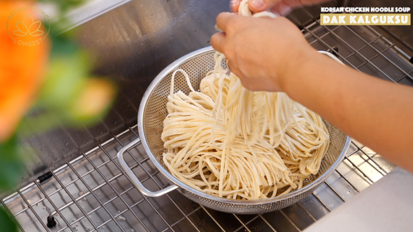 Korean Chicken Noodle Soup, preparing fresh Kalguksu noodles