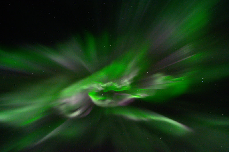 Aurora Corona - Diverging rays of green and pink northern lights directly overhead