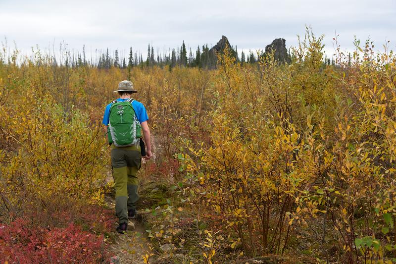 Hiker approaching the granite tors in fall