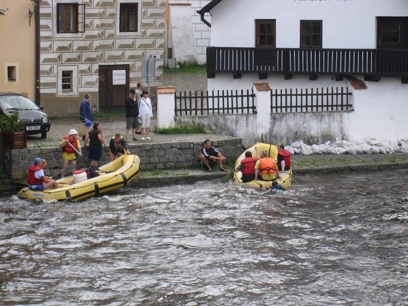 people swimming to shore in Cesky Krumlov