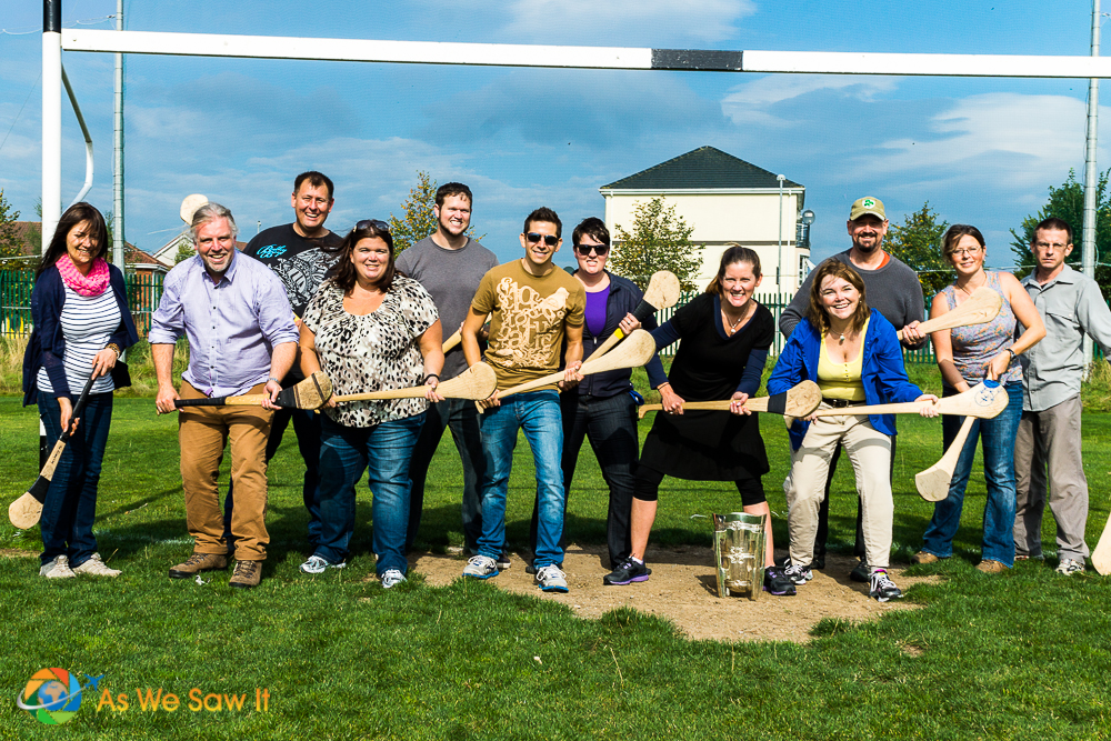 Posing with hurling sticks - We had a chance to try hurling, and it was a lot of fun!