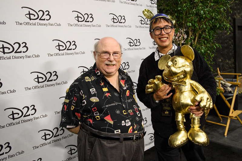 Master Disney Animator Eric Goldberg poses with a guest at<br /> D23's 10-Year FAN-niversary Celebration at the Walt Disney Studios, March<br /> 10, 2019.