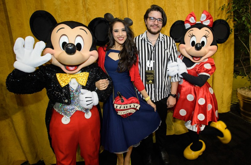 Guests pose with Mickey Mouse and Minnie Mouse at D23's 10-<br /> Year FAN-niversary Celebration at the Walt Disney Studios, March 10, 2019.