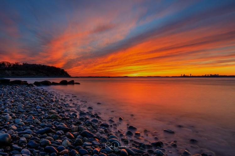 Windmill Point Sunset in Hull, Massachusetts. Boston skyline seen in the distance