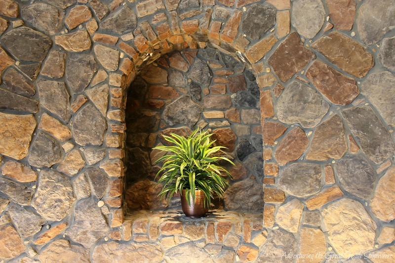 A green potted plant inside the stone turret of Loews Sapphire Falls Resort at Universal Orlando