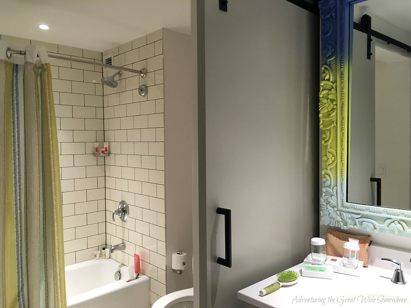 Split view of the prep and shower areas in our standard Sapphire Falls Resort guest room.