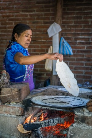 making traditional corn tortillas in Oaxaca