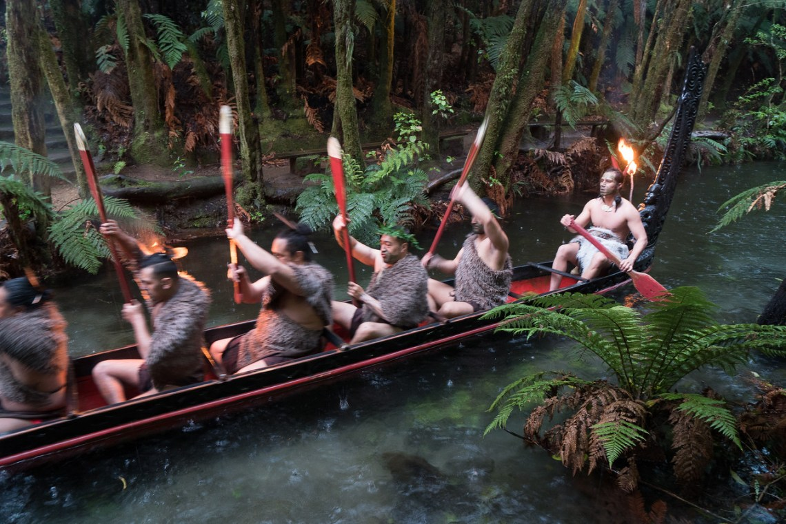 Maori Warriors Rowing their Waka in the Rain in Rotorua