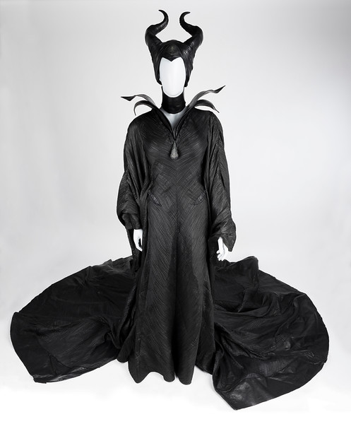 "Maleficent - costume, black ""Christening"" dress, black collar, black corset, black boots, black headdress w/ horns, black spine ring (08456). Change #2, Sc: 88-89"